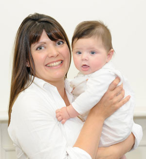 Sam Burlton founder of So Organic with her baby daughter