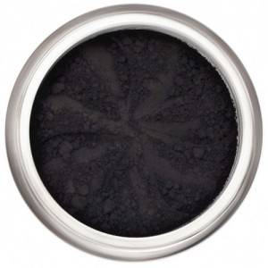Matte black in a natural loose mineral powder formulation.