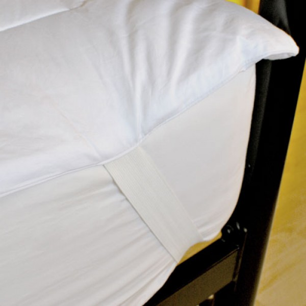 Strong elastic bands loop over the corners of your bed to keep your mattress topper in place
