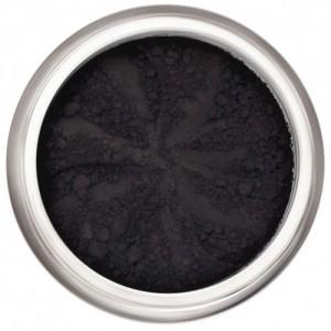 Matte black in a natural loose mineral powder formulation.