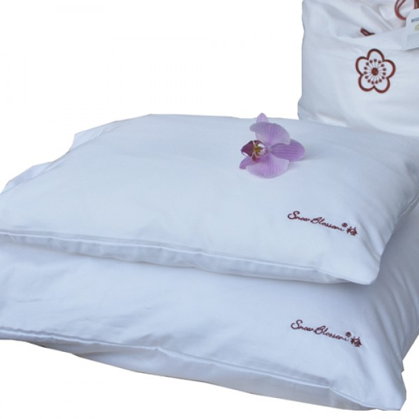 Treat yourself to the comfort and luxury of a beautiful silk pillow